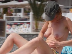 Redhead with big areolas at the topless beach videos