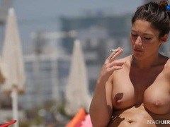 Drinking and smoking babe at the beach videos