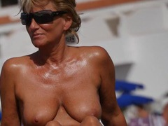 Nice tanned milf with big boobs at the beach videos