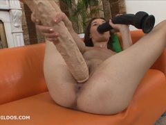 Hungry brunette sucks on a big dildo as the other fills her videos
