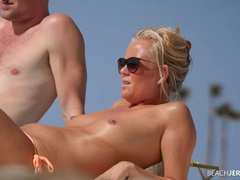 Topless milf works on her tan and gets spied on videos