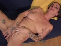 Tattooed old slut with nice tits rubs her snatch movies at sgirls.net