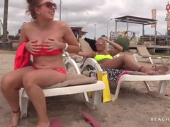 Big natural boobs on a chick at the beach videos