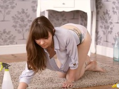 Cute brunette cleans the floor in a loose blouse videos