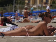 Tight tanned body on a chick at the topless beach tubes