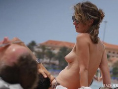Spy on lots of nice tits at the beach videos