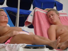 Blonde and her mom topless on the beach movies at adspics.com