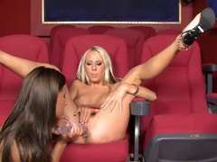 Lesbians in a home theater fuck their toys videos