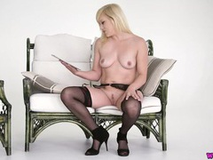 Blonde reads a dirty story in sexy lingerie videos