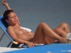 Ponytail babe on the beach has great tits tubes