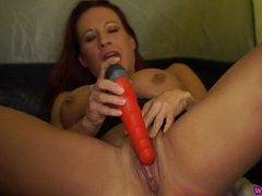 Redhead talks filthy as she fucks a dildo videos