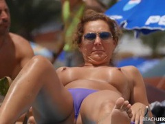 Topless milf gets some sun in the sand videos