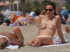 Perfect tits spied on at the topless beach videos