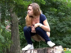Chick pulls down her jeans and pees on a stump videos