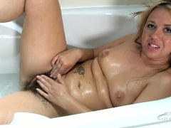 Hairy mom pussy needs to get clean in the bathtub movies at lingerie-mania.com