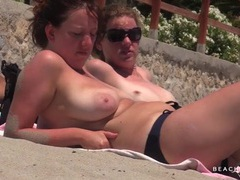 Tanning ladies go topless in the sand videos