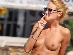 Skinny chick smokes on a topless beach movies at sgirls.net