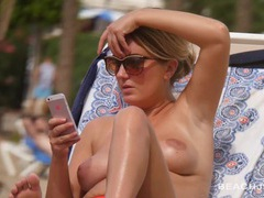 Topless chick lounging on the beach movies at find-best-panties.com