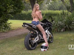 Stunning biker babe in a fantastic black bikini videos