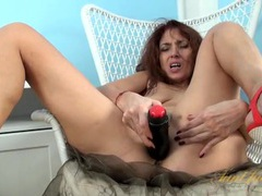 Big black dildo pushes into a hot mature pussy videos