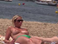 Spying on a beach milf with great tits videos