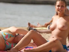 Topless cutie has fun hanging out on the beach movies