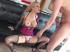 Tattooed milf temptress with fake tits fucks him videos