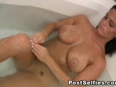 Curvy young brunette takes a sexy bath tubes
