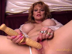 Long dildo fucks a mommy with fake titties tubes