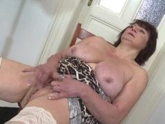 Masturbating granny fondles her big tits videos