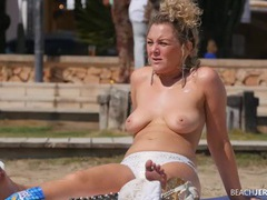 Curly hair milf with her tits out as she tans videos