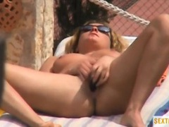 Tanning babe caught masturbating outdoors videos