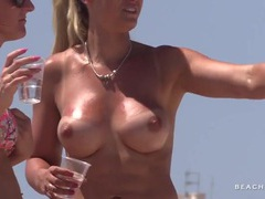 Blonde beach babe has a pair of fake tits movies at freekilosex.com