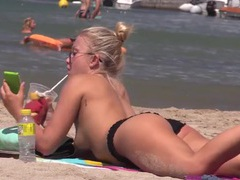 Topless cutie eats a fruit cup in the sand movies at find-best-lesbians.com