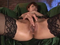 Asian erotically rubs her lubed up pussy tubes at korean.sgirls.net