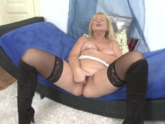Granny slut in stockings fingers her hot box movies at adipics.com