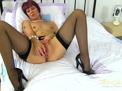 Classy mom in a pearl necklace masturbates solo videos