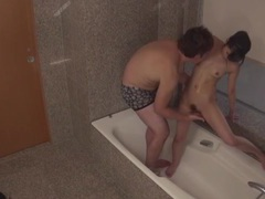 Showering with his asian gf and fingering her tubes