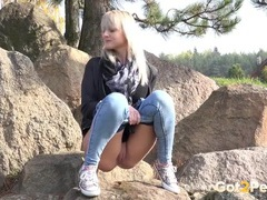Blonde filmed taking a piss on a rock videos