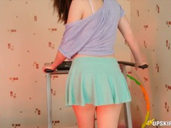 Sweet girl works out in a pleated skirt videos