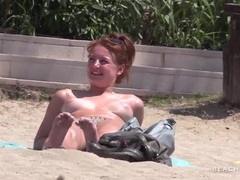 Cute redhead tans topless with her friends videos