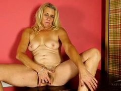 Mature blonde drops her panties to finger solo videos