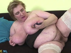 Nasty old fat chick fucks a toy into her cunt videos