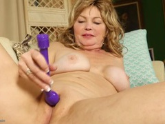 Mom plays with her asshole while masturbating videos