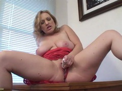 Big natural milf titties on a lady that loves her toy videos