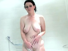 Mom cleans up her hairy pussy in the bathtub movies at kilopics.net