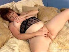 Shaved mature gash is gorgeous as she plays with it videos