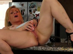 Mom on her kitchen counter masturbates passionately videos