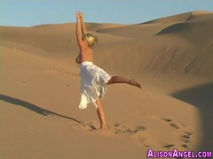 Bendy busty teen babe shows off natural assets on sand dunes tubes