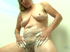 Mom soaps up her hairy cunt and tits in the tub movies at kilopics.net